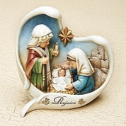 Holy Family Nativity figurine Heart Shaped Wings around Childlike Figures made of Resin measures 5 and 1 quarter by 5 and 1 quarter inches RO66039