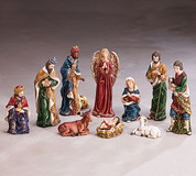 10 Pc Traditional Nativity Jewel Tones Hand-Painted on Porcelain include Jesus Mary Joseph 3 kings 1 shepherd 1 angel 1 ox and 1 lamb ranging from 2 to nine and 1 half inches BUR9728404