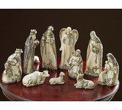 10-Piece-Modern-Nativity-Set-with-Jesus-in-Mary's-arms-Joseph-3-wise-men-1-angel-1-shepherd-1-ox-1-donkey-1-lamb-made-of-Stone-Look-rising-Ivory-with-Gold-&-Silver-accents-tallest-piece-measures-11-inches-BUR9728405