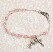 First Communion Bracelet with Rhodium-Plated Blessed Sacrament and Crucifix Charms with 5 millimeter pink crystal Beads measures 6 and 1 half inches MABR277RW
