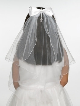 First Communion Veil with bow and comb headpiece  features cross charm measures 20 inches with Finished EdgeS RO65392