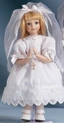 First Holy Communion Doll with Blonde Hair has Veil and Bead Accessories Included made of Porcelain measuring 12 inches RO40330