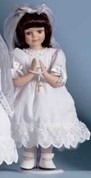 First Holy Communion Doll with Brunette Hair has Veil and Bead Accessories Included made of Porcelain measuring 12 inches RO40340