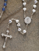 Communion Rosary Beads With Blessed Sacrament Centerpiece and 6 millimeter White Glass Heart-Shaped Beads measures 16 inches RO62154