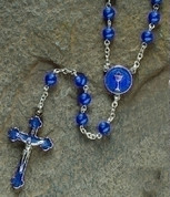 Communion Rosary Beads With blue enamel on silver finished metal Blessed Sacrament Centerpiece and 6 millimeter blue Glass Beads measures 16 inches RO62155