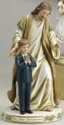 Jesus and boy First Communion Figurine with Sentiment saying My First Communion made of Resin measures 9 and 1 half inches high RO47745