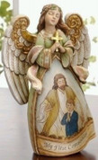 Jesus angel and boy First Communion Figurine with Sentiment saying My First Communion made of Resin measures 7 and 1 half inches high RO61062