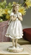 prayerful girl First Communion Figurine with Sentiment saying My First Communion made of Resin measures 6 and 1 half inches high RO47746