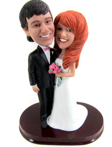 Strapless bride with tuxedo groom cake topper