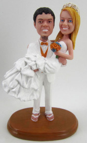Groom in Flip Flops Carrying Bride Cake Topper