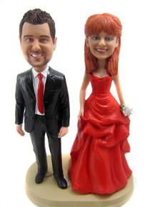 Custom made wedding anniversary cake toppers look like the couple!