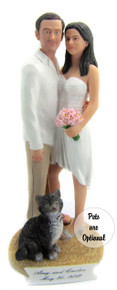 Casual couple on the beach wedding cake topper