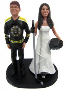 Hockey player bride wedding cake topper