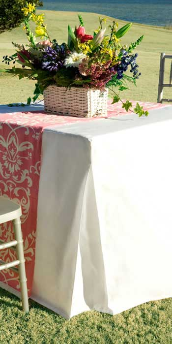 White fitted table cover outdoors