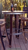 A tall barrel-top Bistro Table has galvanized steel accents around the table rim, footrest, and matches the Bartoli Bistro Chair. Chairs and wine not included.