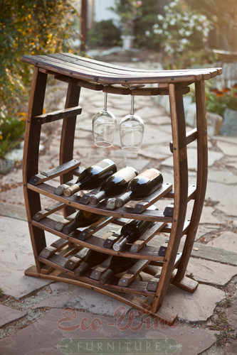 "This stand-up wine rack features room for 2-4 hanging glasses above, and storage for 14 wine bottles below. An impressive way to display your favorite glassware & wines. Wine and glasses not included. 32""H x 25""W x 12""D"