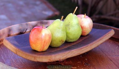 This all-oak platter has a curved, concave design with a smooth finish. Works well as a fruit or bread tray and sits on a pedestal.