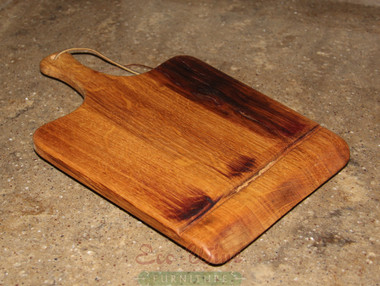 The platter made from staves has an extended wooden handle. This is perfect for serving your favorite cheeses and breads.