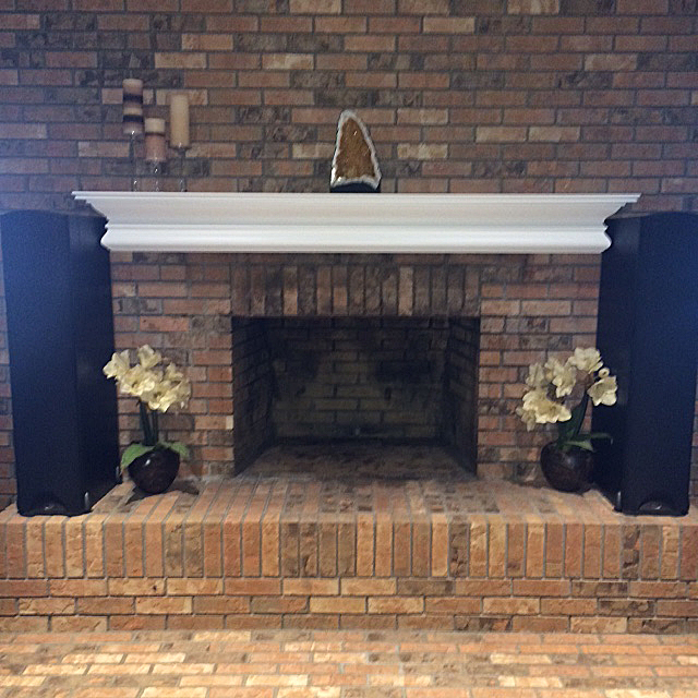Finished installation of white mantel shelf