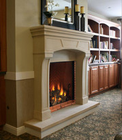 The Bungalow stone fireplace mantel shown with raised hearth.
