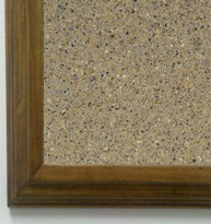 "Tan granite tack board with 1 3/4"" frame"