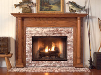 Large columns add character to the Georgian Fireplace mantel.