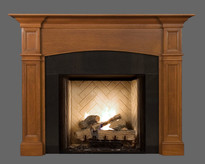 The Hartford mantel is shown here with Absolute Black granite
