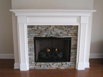 A beautiful fireplace mantel, painted white