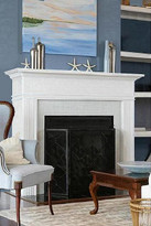 A Montecito cabinet mantel with a fireplace insert not recessed into a wall