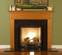 The Sterling fireplace mantel has fluted legs and dentil on breast plate