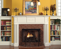 the victoria mantel surround has column legs with latern appliques