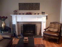 A fireplace update, featured an Oxford mantel painted white