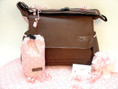 Jimeale diaper bag in chocolate brown with sophisticated pink lining and trim