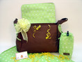 Celebrity favorite Jimeale diaper bag in chocolate brown with green trim, includes convenient changing pad and bottle insulator