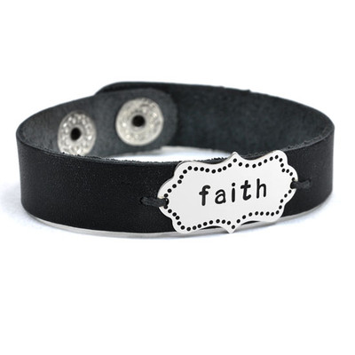 """Hand stamped leather cuff shown with word """"faith"""""""