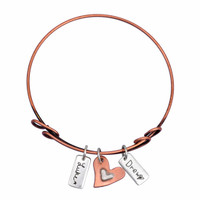 Signature charms on adjustable bangle