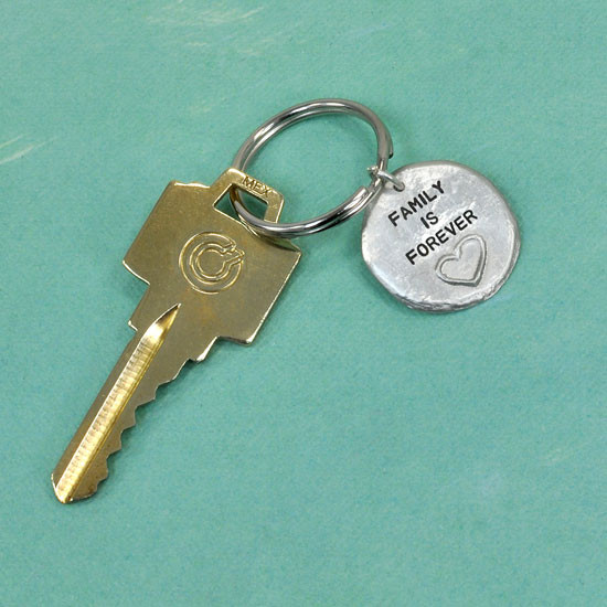 Hand stamped heart key chain with key, saying Family is Forever