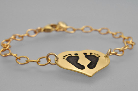 Your baby's footprints on a gold bracelet