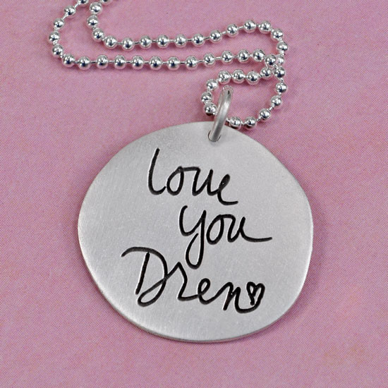 Handwriting on silver pendant
