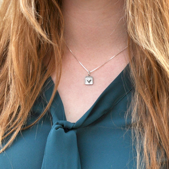 Chunky sterling silver heart on square
