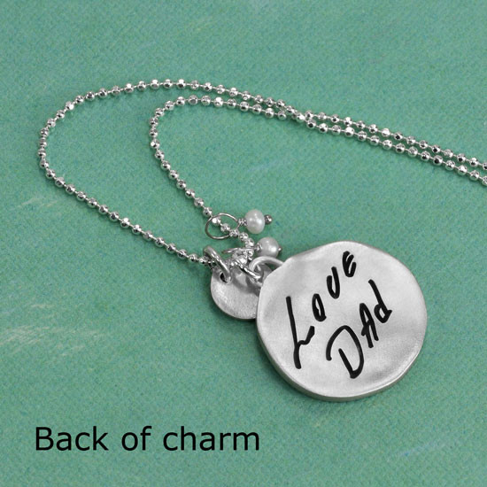 Dad's signature on back of necklace