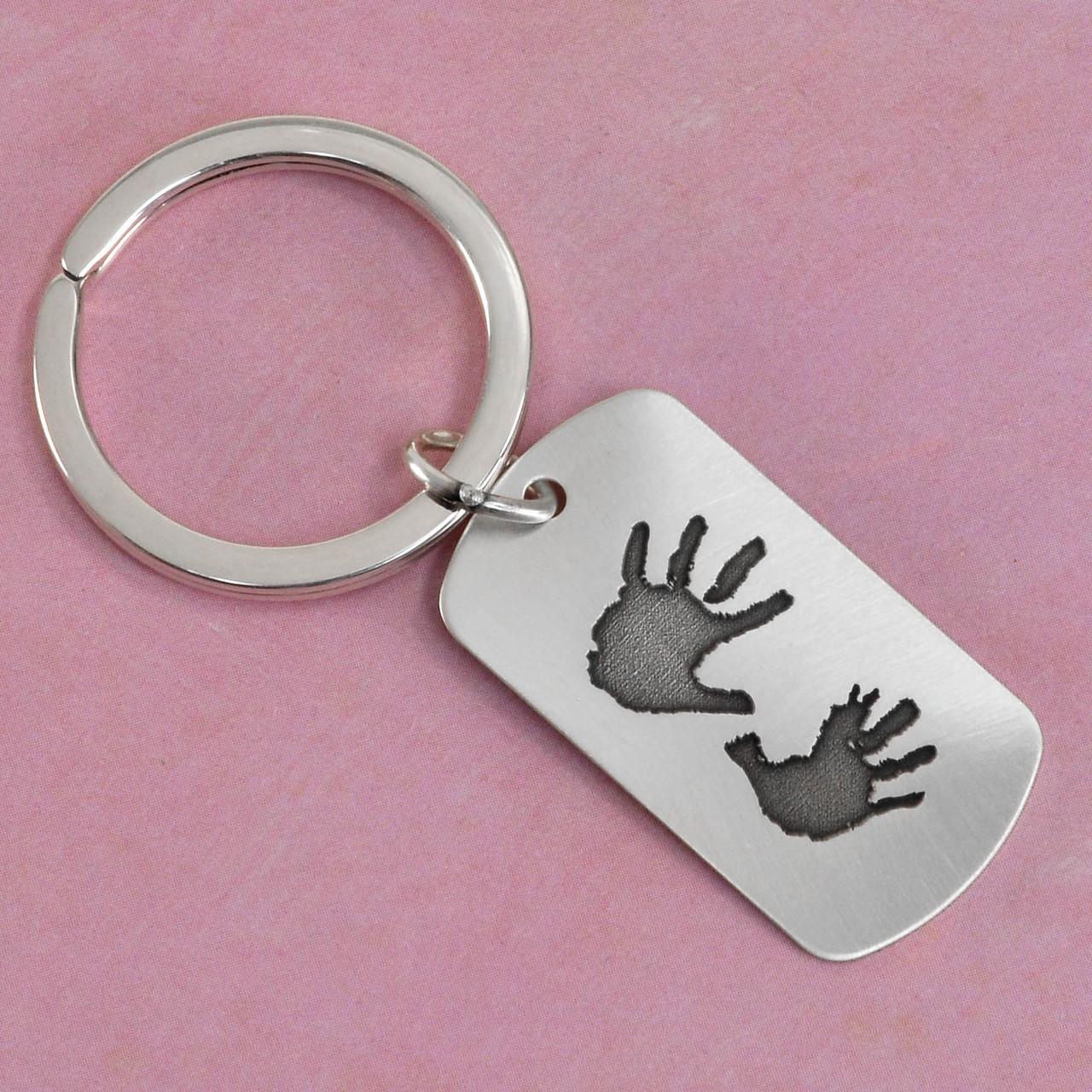 Hand prints on a key ring