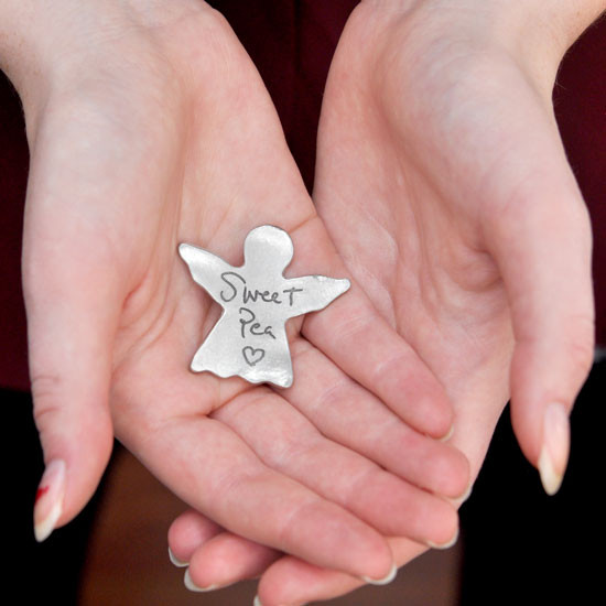 Angel pocket token with custom handwriting