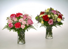 Clear gathering vases filled with colorful roses, carnations, baby breath or designers choice of unique filler