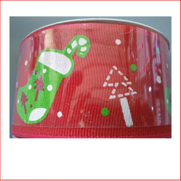 Red Ribbon with Green Stocking 38mm is a modern/contemporary style ribbon which is great for decorating colour christmas displays