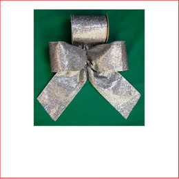 Silver Lame with Sparkles-100mm Single Bow looks great with the final touch of the glitter which sparkles through the bow. Silver Lame with Sparkles-100mm Single Bow is pre made by our designer team to suit all garlands, wreaths, christmas trees and wall sequoia's. Silver Lame with Sparkles-100mm Single Bow is very classy and a favourite for corporate clients. The colour silver is stylish and contemporary