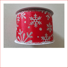 Christmas Ribbon Red Satin and Silver Glittered Snowflakes -65mm looks great with the final touch of the glittered snowflakes. Red Satin and Silver Glittered Snowflakes -65mm is a ribbon that is used very frequently with our designer team decorating garlands, wreaths, christmas trees and wall sequoia's. Red satin is very classy and a favourite for corporate clients. The colours red and silver are just magical as red and silver are the contemporary trend of this day and age.