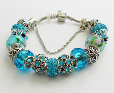 Silver Bangle and Blue hand made beads.