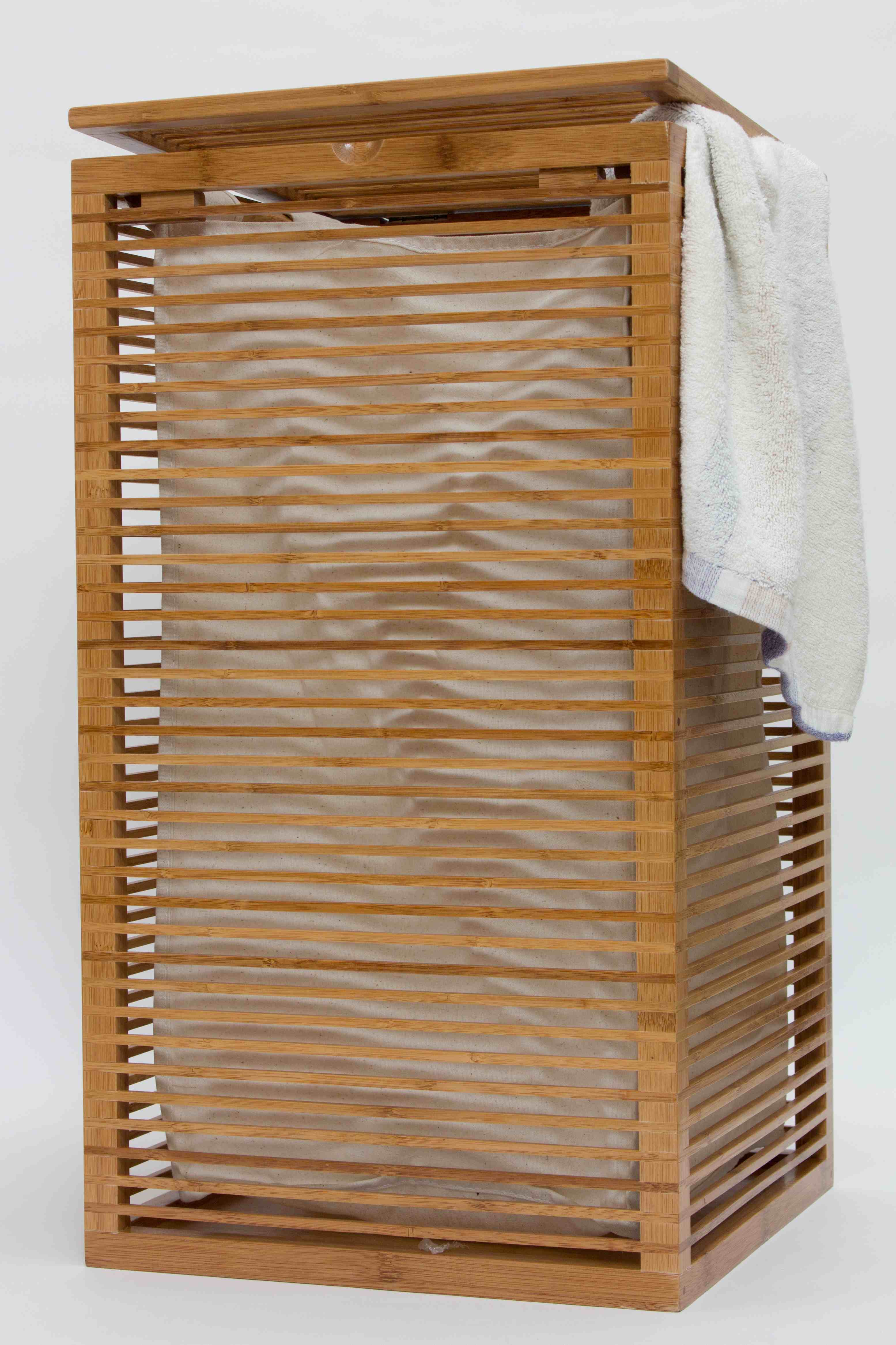 Slim open slats design bamboo laundry hamper for the apartment and loft dwellers in this - Bamboo clothes hamper ...