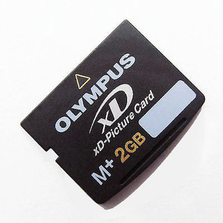 OLYMPUS XD-Picture 2GB : 1     Dimensions:.1 in. H x 1.14 in. W x .67 in. L     Materials:Electronic components     Model No:M-XD2GMP     Support your digital camera's storage perfectly with this digital memory card     Olympus memory card is the only xD card to feature support for Olympus' Panorama function     xD M+ memory cards are designed for Olympus digital cameras     Olympus xD M plus Picture Card is compact for smaller and more stylish digital devices     Memory card works quickly and easily for transferring images and data to a computer     Card features 2GB of storage space     Durable and reliable Compatible to all Olympus and Fuji xD m+ compatible devices     Compatible with most manufacturers' xD M+ compatible devices     Type M+ xD-Picture card is compatible with all xD-compatible cameras and is 1.5 times faster than the              previous Type M card       Increase in speed may be useful in sequential shooting of digital stills and in the recording of high-density          video with Olympus cameras